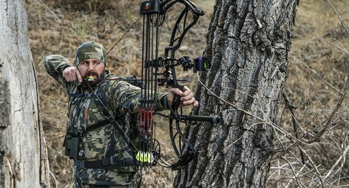 Bowhunter in woods