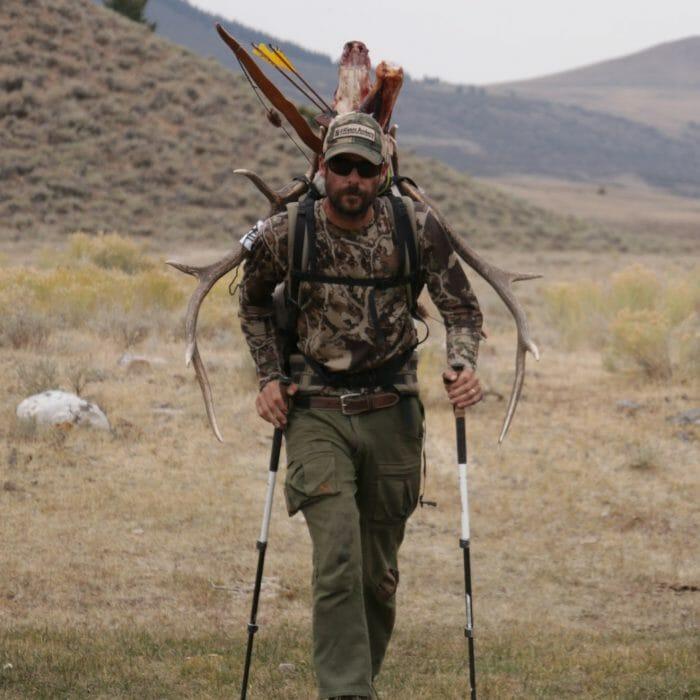 Hunter with Elk head