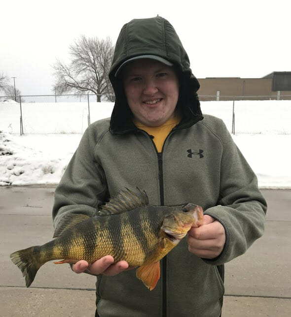 Tyler Halley of Maryville is now a state-record-holder after catching a 1-pound, 14-ounce yellow perch on a private pond in Nodaway County Jan. 24.