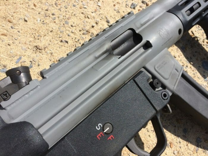 "Notice the lack of weld lines anywhere on the BAP9's receiver, save perhaps the rear sight base. The ""weldless"" finish is most apparent where the cocking tube meets the receiver. Also note how the Cerakote finish collects dirt and grime when the gun is fired with a suppressor."