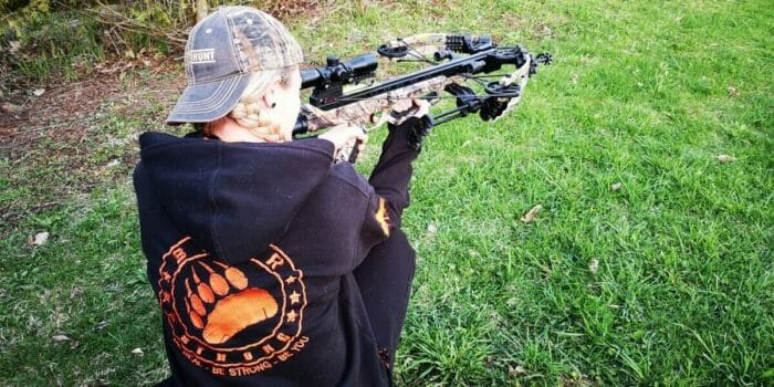 Rae takes aim with her crossbow