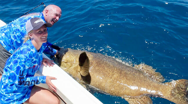 Fishing guide Paul Hartman and stepdaughter Reegan Werner with a record-class goliath grouper, named My Lord.